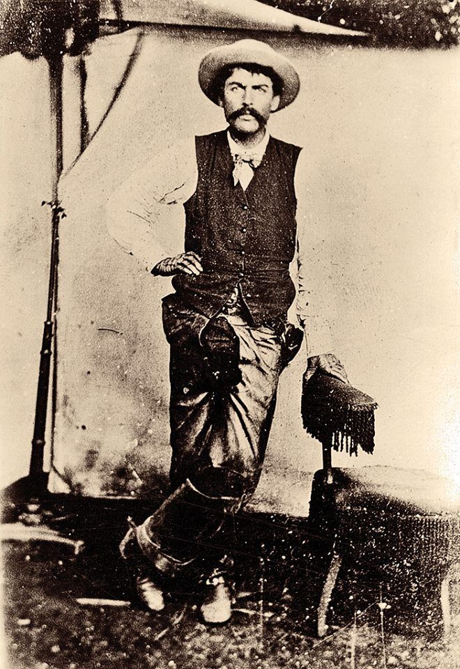 Fred Waite, one of the cowboys who fought in New Mexico's Lincoln County War alongside Billy the Kid, never turned outlaw. This circa 1870s photograph of the part Chickasaw born in Indian Territory reveals unusual fashion for a cowboy: tight-fitting kid gloves and a narrow brimmed hat.   – Courtesy Robert G. McCubbin Collection –