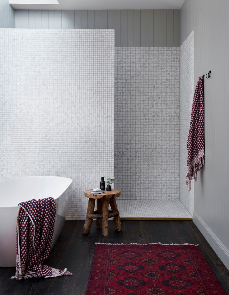 White marble cloud mosaic tiles by National Tiles and hand-crafted rugs by Decorug