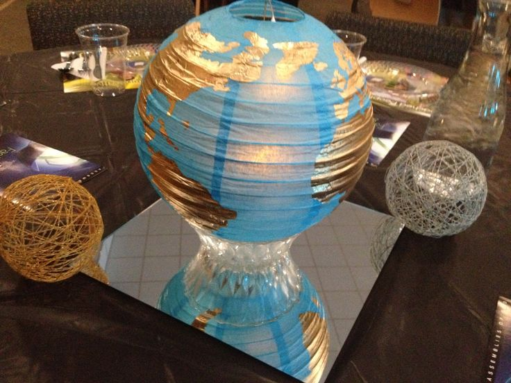 Lantern centerpieces for missions banquet. Painted the world map on each with gold foil.