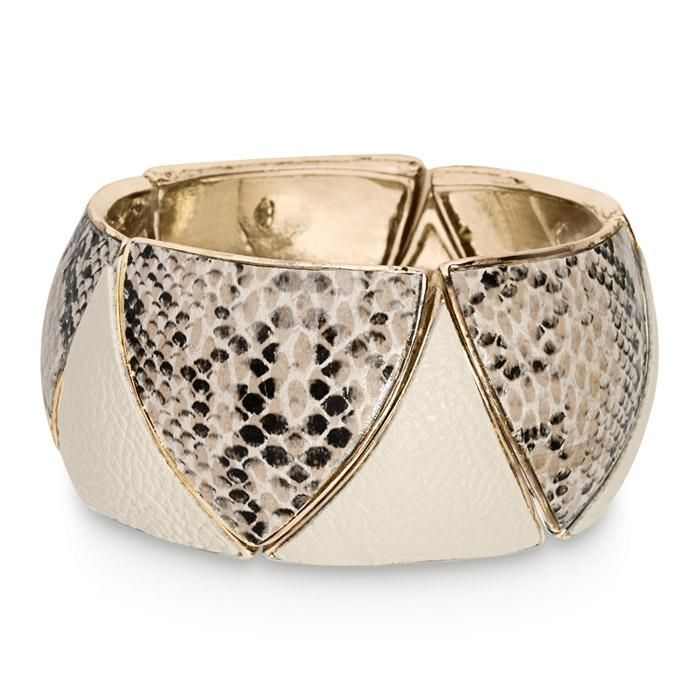 Add some bite to your outfit with this mixed-media bangle-the snake-printed faux leather and burnished-goldtone pairing is sss-uper-sleek! Regularly $24.00, buy Avon Jewelry products online at eseagren.avonrepresentative.com