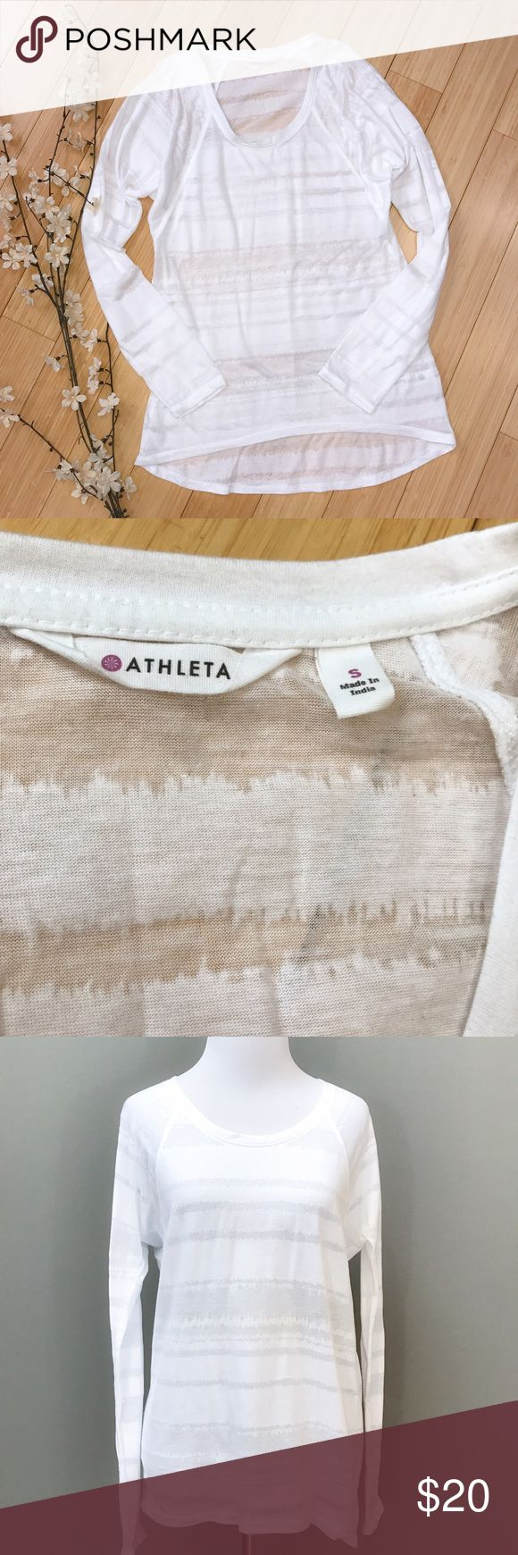 ATHLETA white shirt, S. Really nice white shirt by Athleta, size small. The shirt is sheer and is meant to go over a cami, a brightly colored sports bra, or a bathing suit. Slight batwing sleeves. Bust is 19 inches, length is 26 inches in the front, 29 inches in the pack. No flaws, great condition. Athleta Tops Tees - Long Sleeve