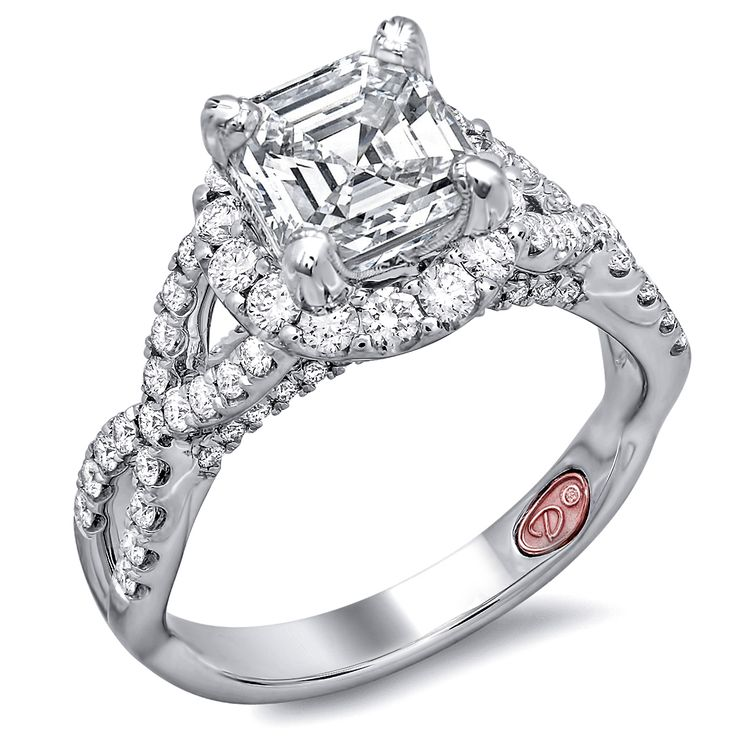Designer Engagement Rings from DemarcoJewelry.com        Available in White or Yellow Gold 18KT and Platinum. 0.75RD    Capture her grace and endless beauty with this confident yet elegant design.  We have also incorporated a unique pink diamond with every single one of  our rings, symbolizing that hidden, unspoken emotion and feeling one  carries in their heart about their significant other.    This is not just another ring, this is a heirloom piece of jewelry.
