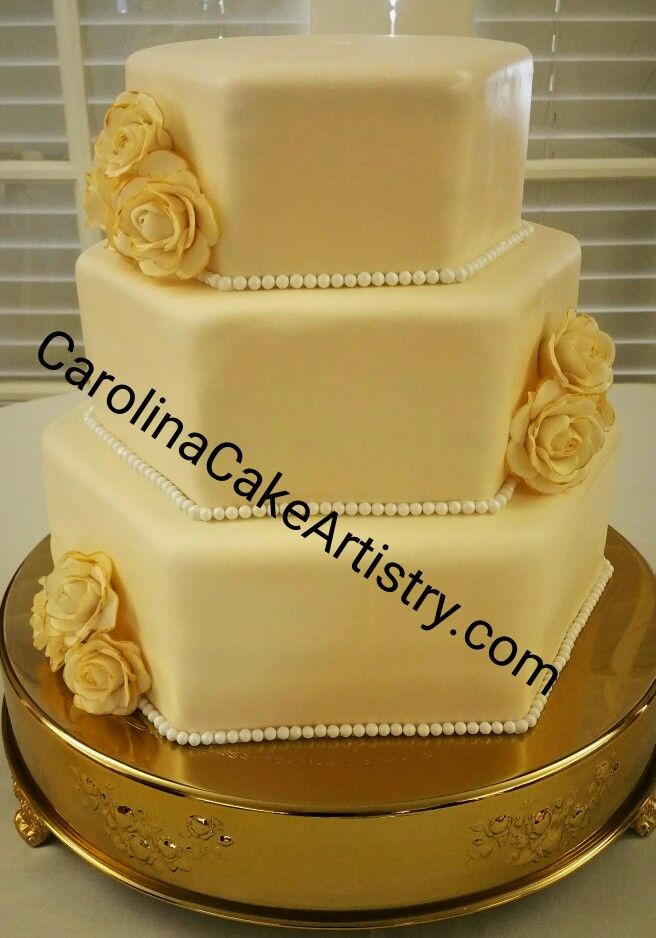 Elegant Ivory Hexagon Wedding Cake with edible gold tipped ivory roses! @Rolling Hills Country Club