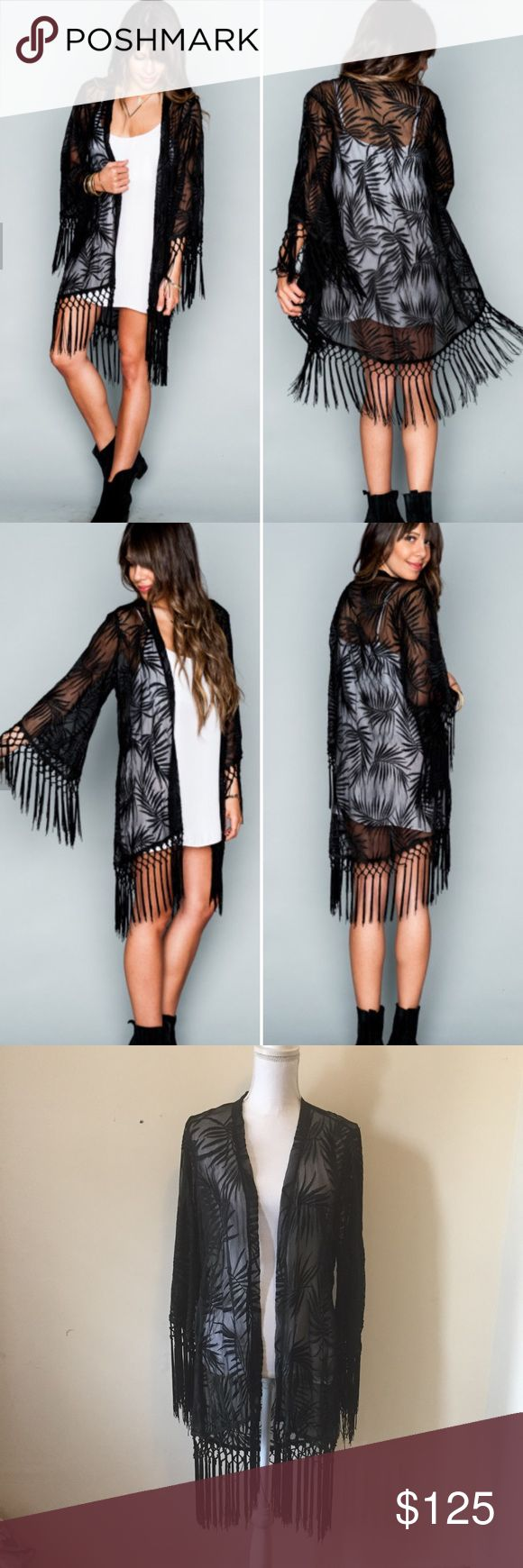 Show Me Your Mumu Metzler Fringe Kimono Leafy Luxe Saunter through the day in the elegant Leafy Luxe Black. Sheer chiffon littered with embroidered leaves give you that perfect ethereal boho look. Metzler Kimono is absolutely the best thing to wear no matter what you're up to. She wraps you up to keep you comfortable, with a dramatic fringe on the end to really show people you have style down to a T.   *100% Poly. Semi-Sheer. Fringe on sleeves and along bottom edge. New with tags. Size…