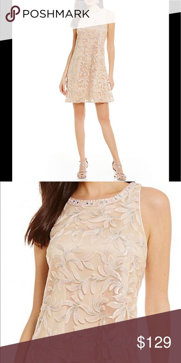 Badgley Mischka River Floral Sequin dress NWT From Belle Badgley Mischka, this dress features:  sequin bodice fabrication  round neckline  sleeveless  v-back styling  embroidered applique detail  center back zipper New with tags  Size 10 Badgley Mischka Dresses