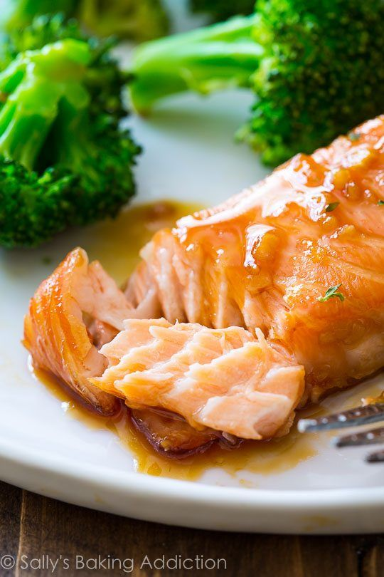 This simple baked salmon is smothered with a 4 ingredient garlic honey ginger glaze and is ready in under 35 minutes!