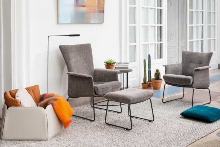 Aida | JORI - Amazing seating comfort in a very light and ultra compact creation. Refined armchair with low or high back and matching footstool fit perfectly in smaller interiors.