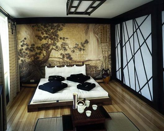 JAPAN - The low bed and walnut colour scheme create a traditional look in this Japanese-inspired bedroom. The wall mural is beautiful too, giving a peaceful vibe to this room. Giant sliding doors finish the look.