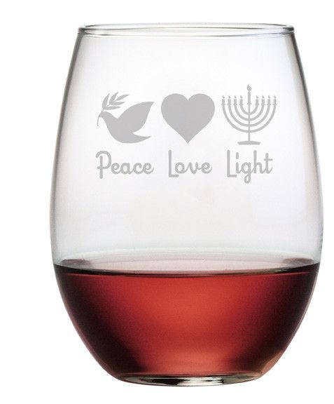 Peace Love and Light is hand etched on these stemless wine glasses along with beautiful designs.