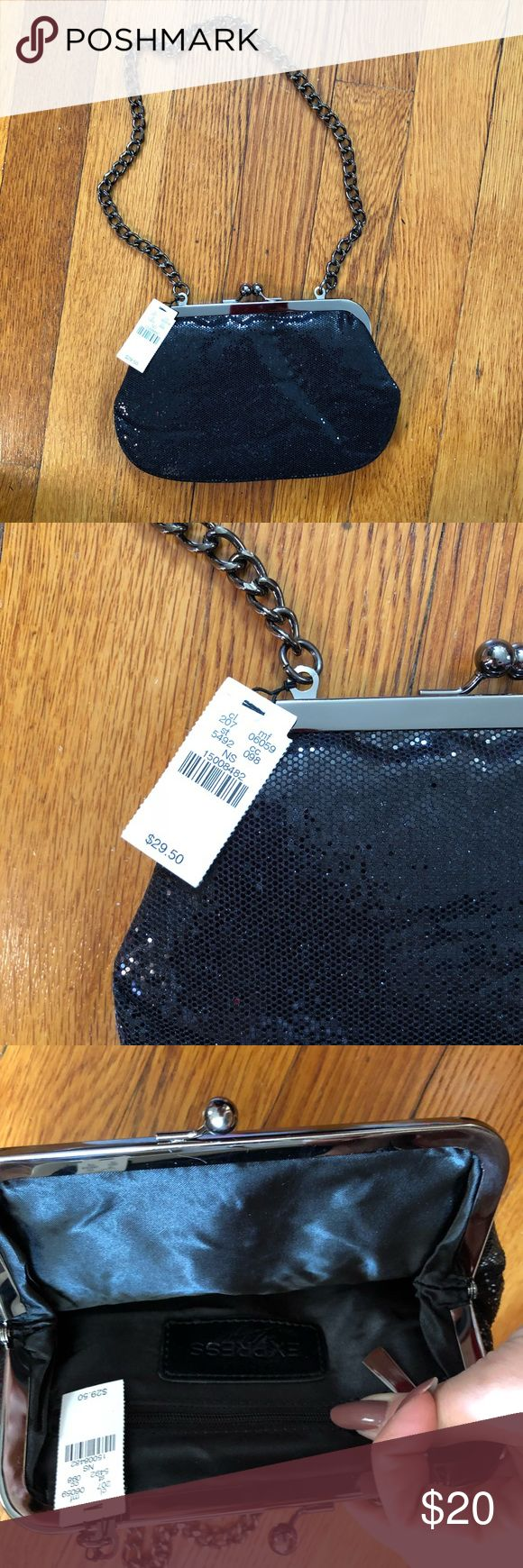 NWT Express Sparkly Clutch NWT Express Sparkly Clutch in Black!  •Brand New! •Great for evenings and parties Express Bags Clutches & Wristlets