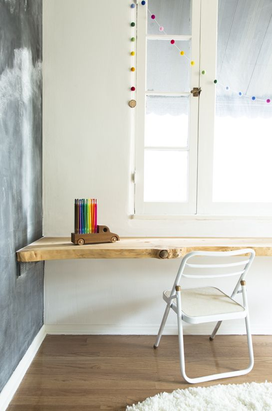 Beautiful wooden built in desk. We love the chalkboard wall too!