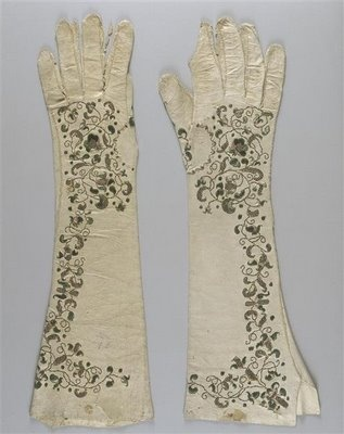 Antique embroidered gloves in musée national de la Renaissance, end of 17th c. to early 18th c.