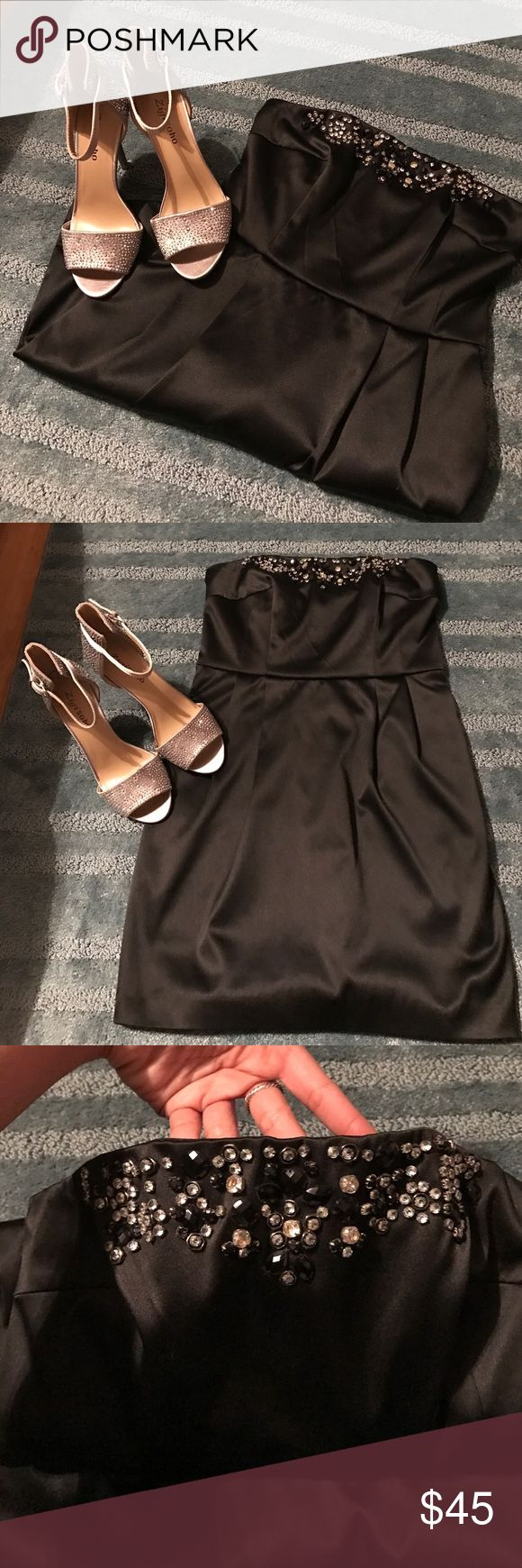 Classic Express LBD This vintage Express LBD is perfect for homecoming or prom for anyone on a budget! All gems are intact and this satin, strapless dress has POCKETS!! Express Dresses Strapless