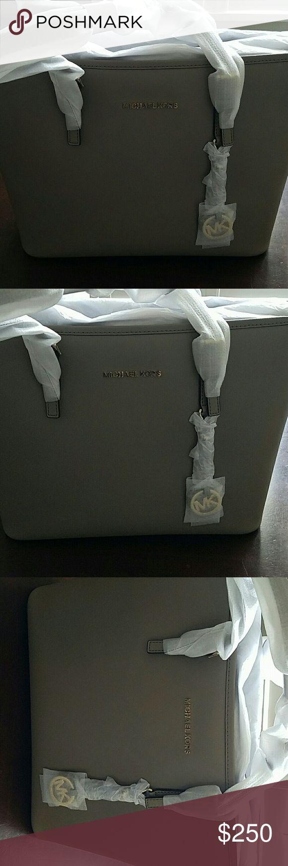 Micheal Kors jet set tote. Brand new with tags  Michael kors Handbag  Never used  Retails for $278. Michael Kors Bags Totes