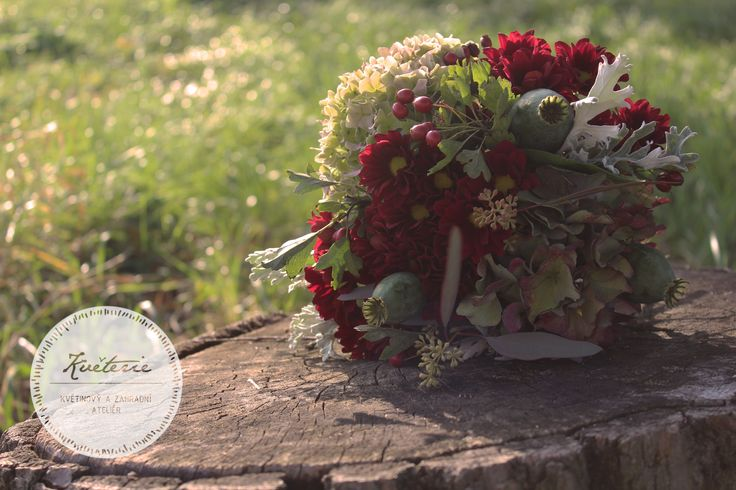 Burgundy late summer - autumn bouquet with dried papaver, hydrangea, berries, red chrysanthemum, eucalyptus and senecio