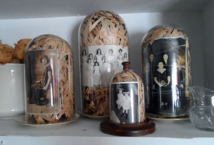 i added these old vintage family photos to glass cloches .. used old shredded book pages  ~mbr~