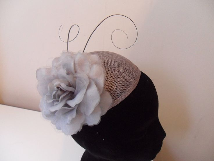 Handmade sinamay pewter coloured fascinator.  https://www.facebook.com/fascinationforyou/