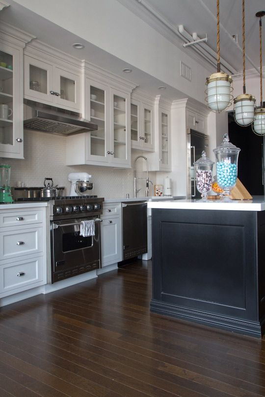 Apartment therapy - Industrial loft kitchen.  black & white cabinets