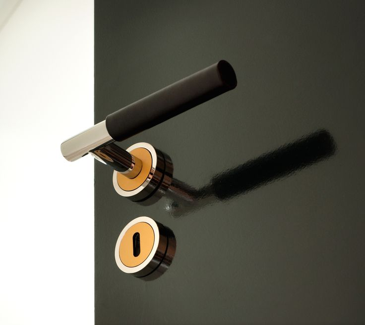 Zegna Lever handles with Keyhole escutcheon. Brown and Orange leather.
