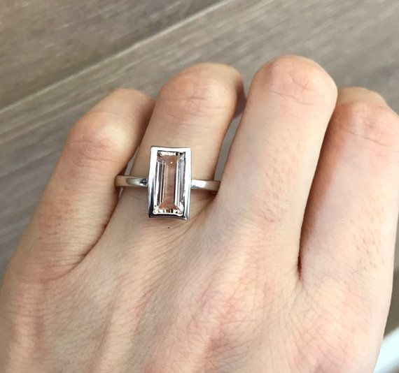 A stunning north south setting featuring a rectangle shaped Morganite bezel set fwith a polish finish makes a lovely engagement/promise/statement ring. Wrapped in a Branded Belesas Box ready for gift giving. (r.b-43)  Morganite measure 11.5mm x 6mm  ---> Dont know your ring size? Purchase our ring sizing gauge https://www.etsy.com/listing/290720637/ring-sizer-ring-sizing-gauge-multisizer?ga_search_query=ring+sizer&ref=shop_items_search_1  *F...