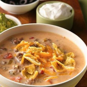 "Beefy Nacho Soup - ""Made this for several friends for a church ladies luncheon. There were raves all around and many requests for the recipe. Because I love them, I will add some black beans to the next batch."""