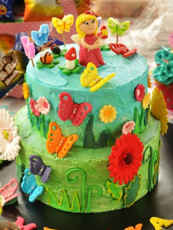 Butterfly garden vanilla cake with buttercream icing.