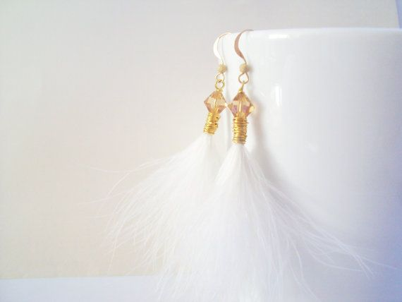 Feather and Swarovski Golden crystal dangly earrings in gold plated brass