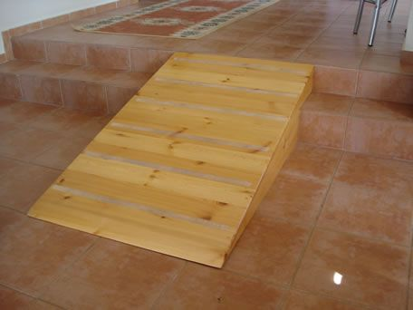 Removable wooden ramp is provided to give wheelchair freedom on split ...