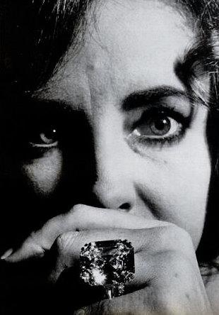 Cripes, look at that rock! liz shows off the KRUPP Diamond Richard Burton bought for her at Sothebys for 305,000 Picture taken from Life Magazine 1969