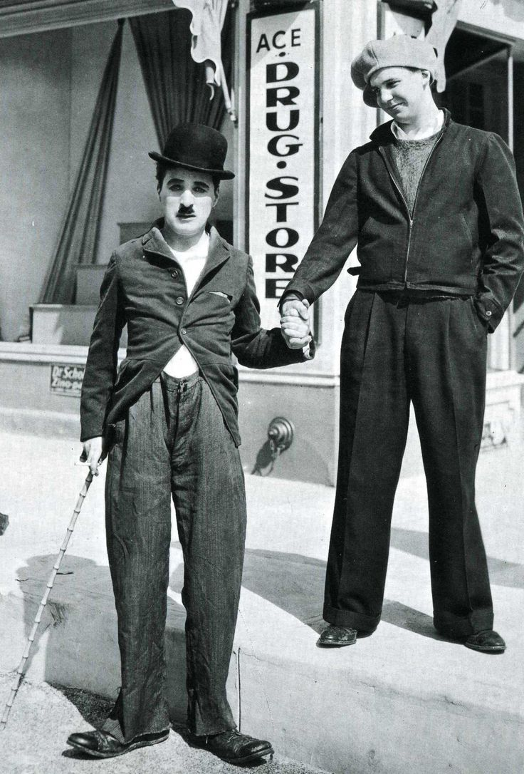 "Charlie Chaplin & Jackie Coogan through the yearsOn the set of ""The Kid"" circa 1920On the set of ""Modern Times"" circa 1935 &The Academy Awards April 10th 1972"