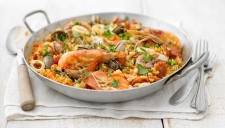 An authentic seafood and chicken paella with calasparra rice and chorizo: Food Recipes,  Hotpot, Rice Dishes, Chicken Thighs, Paella Recipes, Cooking Recipes, Hot Pots, Spanish Rice, Seafood Paella