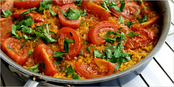 Mark Bittman's simple paella with tomatoes. Photo: Evan Sung for The New York Times