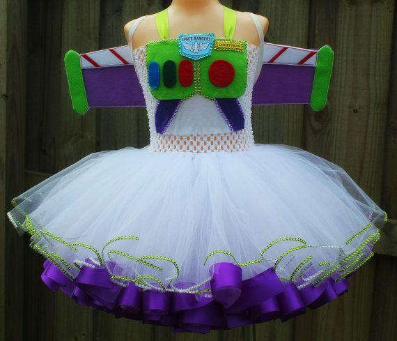 CURRENT PROCESSING TIME IS 4 weeks!!!   This is the perfect Halloween costume for the Space ranger in your life. This would also be so cute for a Toy Story themed birthday party. Definitely a show stopper. This listing includes the Buzz Lightyear inspired tutu dress AND wings. The dress is made with tons of tulle and is trimmed with ribbon and rhinestones and is SUPER full and fluffy. Please allow 4 weeks for the dress and wings to be made.  This would also make a very beautiful Pageant…