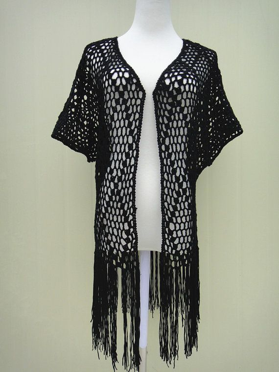 Crochet Fringe Kimono Cardigan Short Sleeve Perfect to creat a boho, hippie chic look or just as beach cover up for you favorite swimsuit.  Measurement Bust 36-40 Length: 25 and 33 with tassels  Crocheted in easy care acrylic yarn, machine wash cool, gentle cycle, and short machine dry, low heat, or roll in a towel to remove excess water and lay flat to dry.  Please be sure to read my policies before purchasing. Feel free to let me know if you need a different color or size. thank you