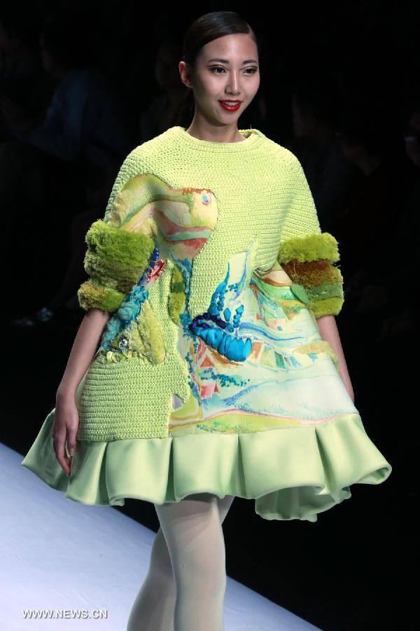 Models present creations in 2014 China Graduate Fashion Week in Beijing
