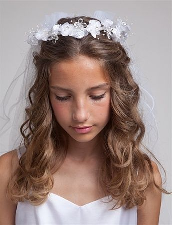 First communion hair. I like the wavy, half up-do.