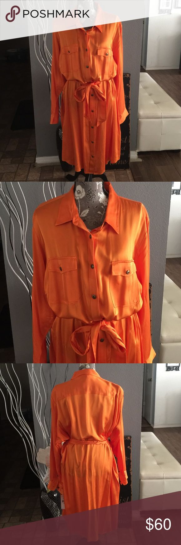 NWT Lauren Ralph Lauren orange shirt dress sz 22W NWT Lauren Ralph Lauren women's orange color long sleeve shirt dress sz 22W . Never worn!! Very sophisticated and classy look for work wear. Material is made out of 100% Viscose. There are no rips tears or odor.  Please refer to pics for true detail description of the condition and please message me if you have any questions thank you and happy shopping! Lauren Ralph Lauren Dresses Long Sleeve