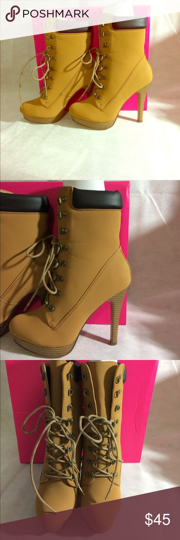 High heel boots This a pair of tan with a dark brown boot high heel. They are true to their size. Shoe Dazzle Shoes Lace Up Boots