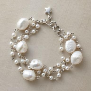 """Au courant pearls by London artist Eric Van Peterson. Three sterling silver strands mingle big baroque gems with smaller exemplars. Handmade with cultured freshwater pearls. Lobster clasp. Approx. 7-1/4""""L."""