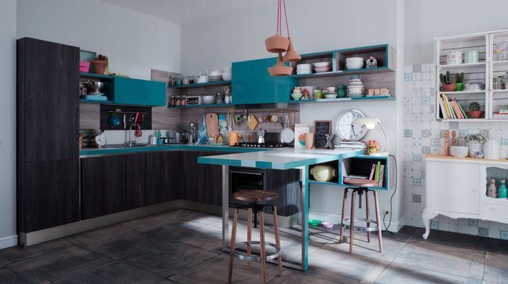 START-TIME.GO 28 Spazio totale alle prese con la necessità di accorpare cucina e living, interpretando le funzioni dell'open space con un design essenziale e al contempo originale, valorizzato dalla finitura olmo e dai colori lucidi e opachi.