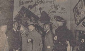 Adolf Hitler and other Nazi officials at the Dada wall at the Degenerate Art exhibition, July 16, 19