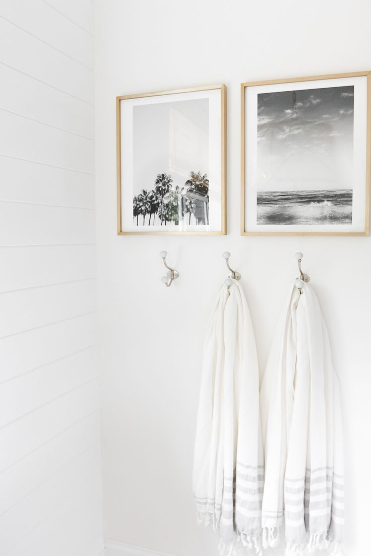 calm, white room with towels