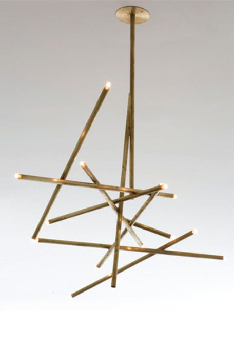"""Even in a semi-traditional setting, this light fixture would add 21st century pizazz! I may need this """"Pick-up"""" chandelier by Billy Cotton..."""