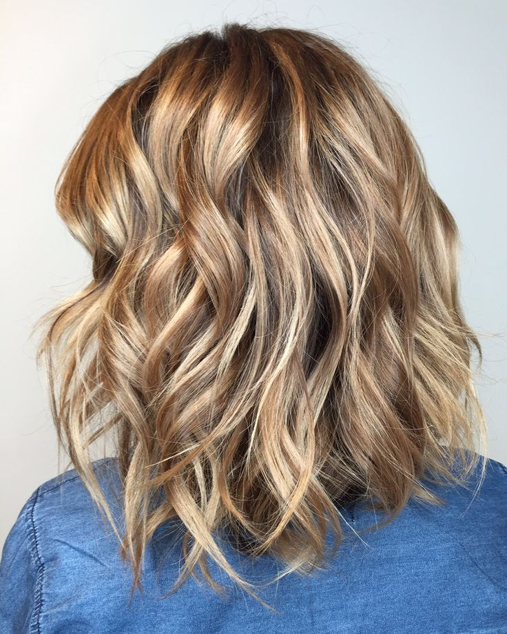 Give your wavy lob extra depth and dimension with hand-painted balayage in beachy, low-maintenance shades of golden blonde and caramel brunette. (Color by Daniel at Asha Salon.)