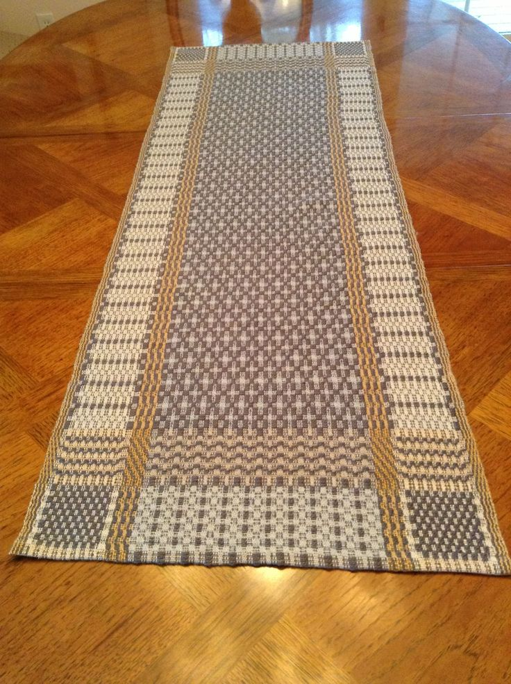 What a difference the color makes!  Lucy D. of Hendersonville, NC wove our Thanksgiving Table Runner (http://www.yarnbarn-ks.com/Thanksgiving-Table-Runner/productinfo/WK-YB-173/) but used the very sophisticated combination of Old Gold, Pale Gray, and Shell.  She opted for a hemmed edge rather than fringe for a simple, elegant look.  A really lovely result!