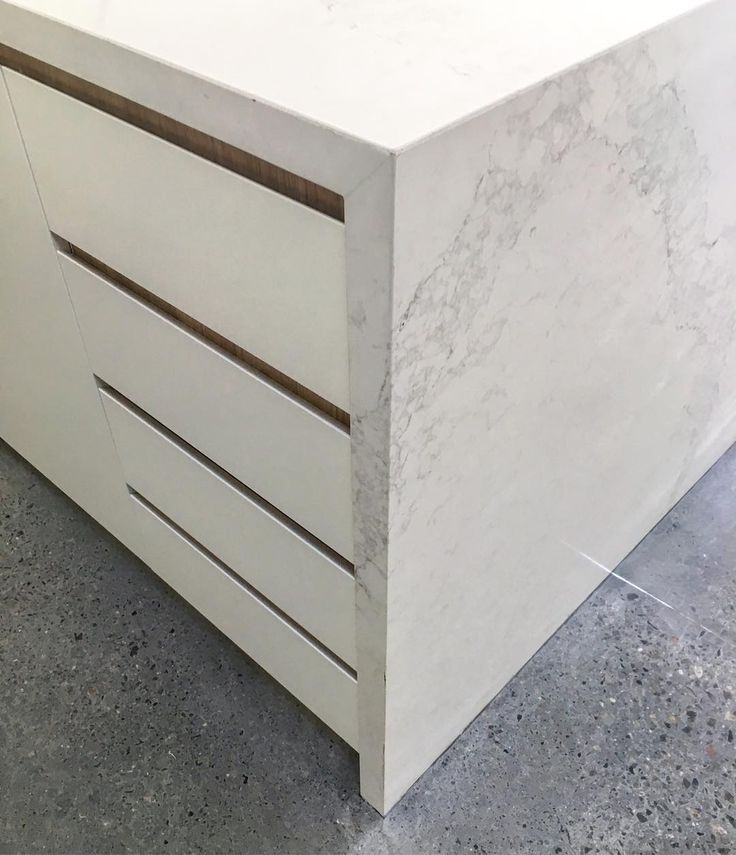 Crisp palette for the kitchen at the Woollhara Terrace. #architecture #residential #design #house #home #terrace #sydney #sydneyarchitecture #interior #palette #caesarstone #polishedconcrete #minimalist