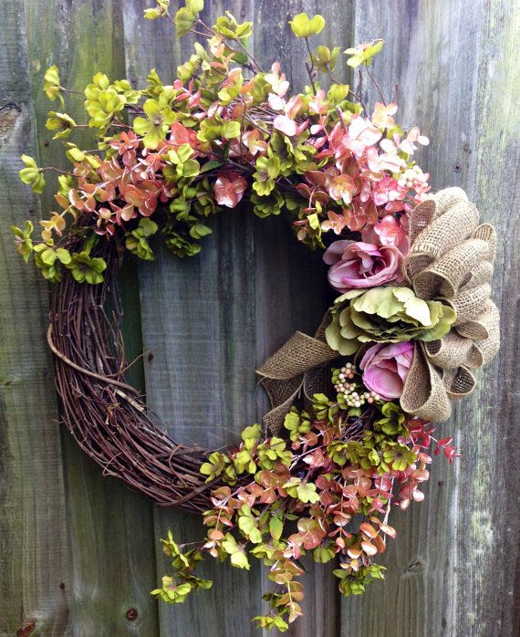 Grapevine wreath with greenery, lush pink florals and burlap ribbon via Etsy