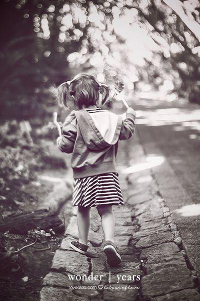 little girl playing on her own wonderyears #wonderyears #play #girl #outdoors by www.lovealda.com