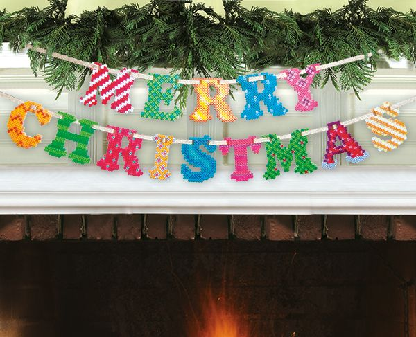 The spirit of the season comes alive with this colorful Merry Christmas Garland made with Perler beads. String the letters in two pieces or one to fit a mantel, window, wall, even the tree!