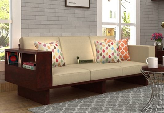 Lannister 3 Seater Wooden Sofa Cream with Mahogany Finish offers a grand size. Buy 3 seater sofa  with storage which can be used to place regular stuff like books and magazines. Get three seater sofa online in #NaviMumbai #Noida #Secunderabad
